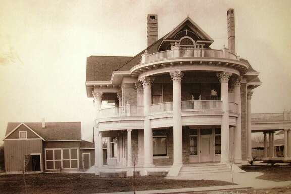 BEFORE: The three-story Neoclassical Revival house in King William as it appeared when it was built by Judge James Luby in 1907.
