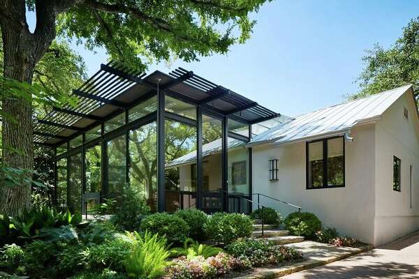 Architect John Grable added a steel-framed, glass walled living room to the front of an Alamo Heights bungalow.