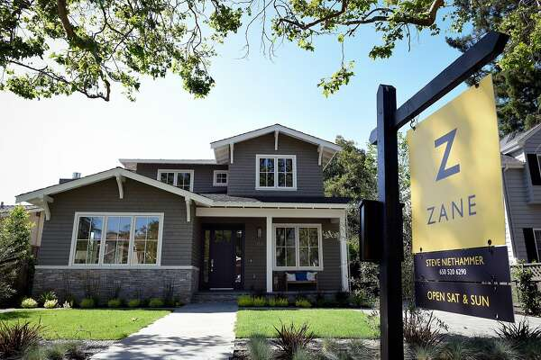 A multi-million dollar home listed for sale on Seale Ave. stands in Palo Alto, CA, U.S., on Wednesday, May 11, 2016. A custom-built home in the heart of California's Silicon Valley had its price cut by $500,000 last week after sitting on the market since the end of March -- a move that would've been almost unfathomable a year ago and a signal that frenzied demand has peaked. Photographer: Michael Short/Bloomberg