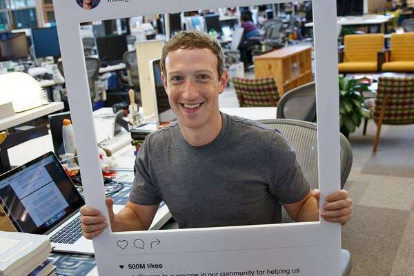 Facebook posted this image of Mark Zuckerberg holding an Instagram cutout.