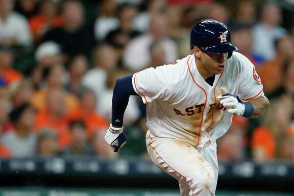 Houston Astros shortstop Carlos Correa (1) runs up the line as he doubled after fouling a ball off of his left leg while at bat during the sixth inning of an MLB baseball game at Minute Maid Park, Wednesday, June 22, 2016, in Houston.