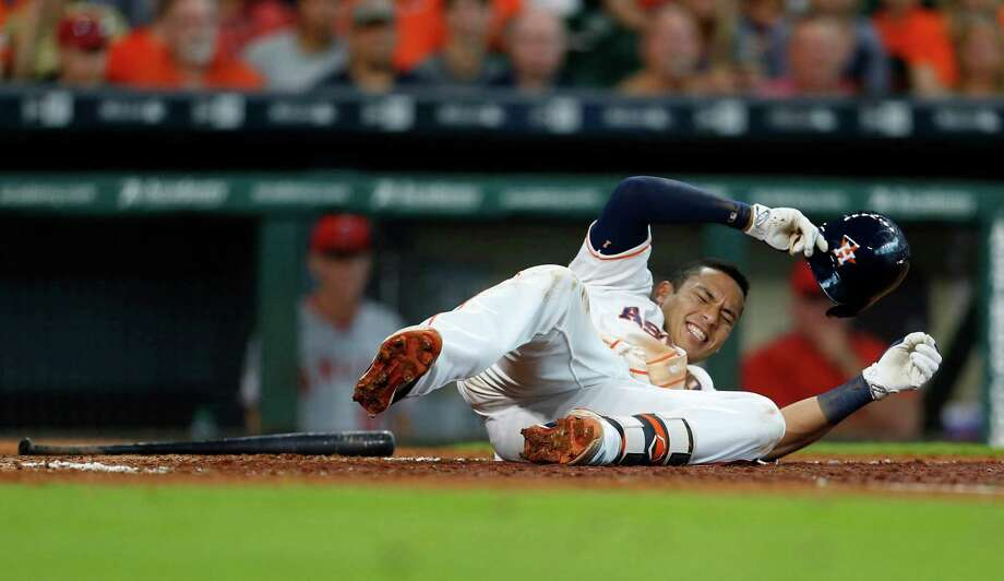 Houston Astros shortstop Carlos Correa (1) lies on the plate after fouling a ball off of his left leg while at bat during the sixth inning of an MLB baseball game at Minute Maid Park, Wednesday, June 22, 2016, in Houston. Photo: Karen Warren, Houston Chronicle / © 2016 Houston Chronicle