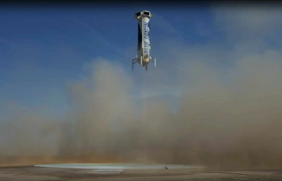 In this photo made from video provided by Blue Origin, New Shepard, an unmanned rocket, prepares to land in an area near Van Horn, Texas, Sunday, June 19, 2016. The private space company run by Amazon CEO Jeff Bezos has completed its fourth successful unmanned rocket launch and safe landing in West Texas using the same vehicle. (Blue Origin via AP) Photo: AP