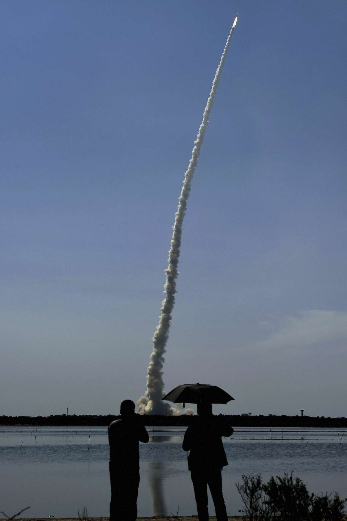 """People watch as Indian Space Research Organization (ISRO)?'s Polar Satellite Launch Vehicle (PSLV C-34) is launched from the Satish Dhawan Space Centre at Sriharikota, India, Wednesday, June 22, 2016. The PSLV-C34 Wednesday successfully launched 20 Satellites in a single flight, an ISRO press release said.  Seattle connection (from news release): Seattle-based """"Spaceflight, the leading provider of integrated launch services for small satellites, today announced it has successfully launched a flock of 12 Planet Dove satellites from India's Polar Satellite Launch Vehicle (PSLV). The 12 spacecraft are shoebox-sized satellites that will be delivered into lower Earth orbit to provide imaging data.""""  (R Senthil Kumar /Press Trust of India via AP)"""