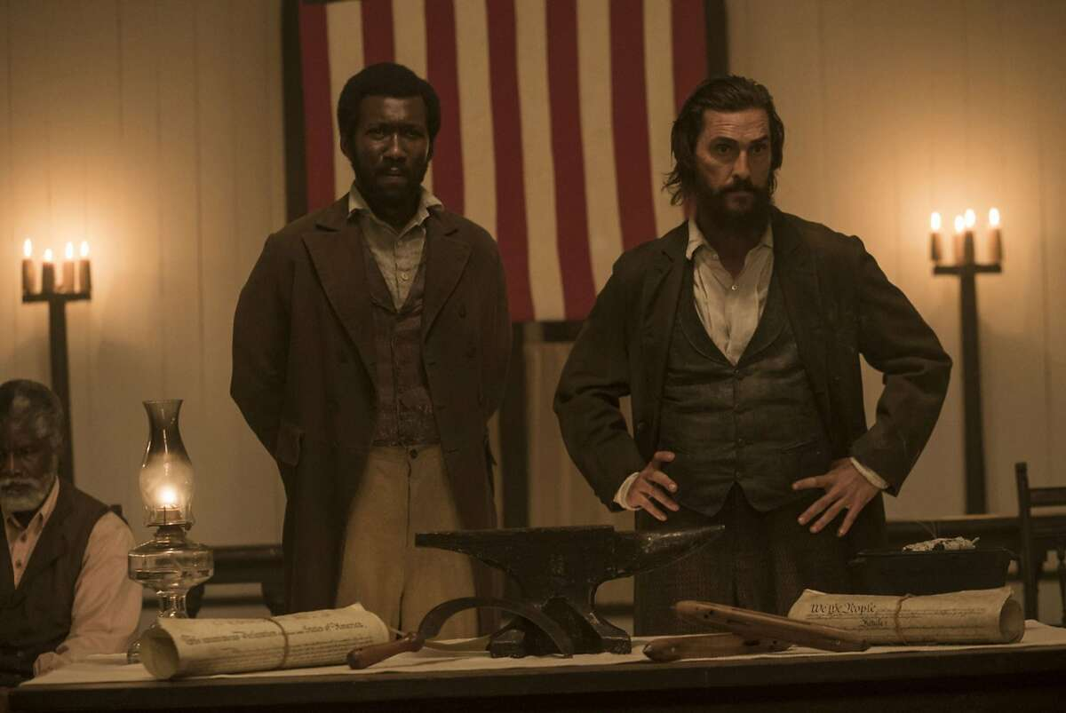 "Mahershala Ali and Matthew McConaughey in ""Free State of Jones."" (Murray Close/STX Entertainment/TNS)"