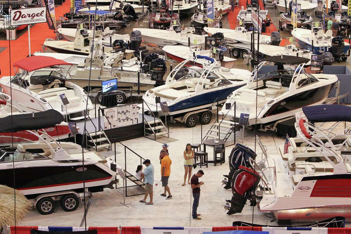 Attendees at the Houston Summer Boat Show look over the latest available boats, cruisers, runabouts, pontoons, kayaks, wakeboard boats, fishing gear, accessories, boating electronics, patio furniture, clothing, jewelry and more on June 22, 2016.
