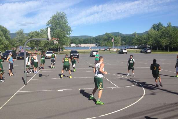 The Siena men's basketball team holds an outdoor practice Tuesday at Veterans Park in Bolton Landing. (Mark Singelais / Times Union)