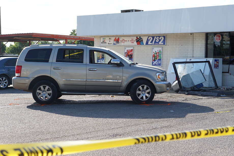 A man was injured Wednesday June 22, 2016 when a driver of an SUV plowed into a store at 4927 Rigsby Avenue on San Antonio's east side. Photo: Jacob Beltran