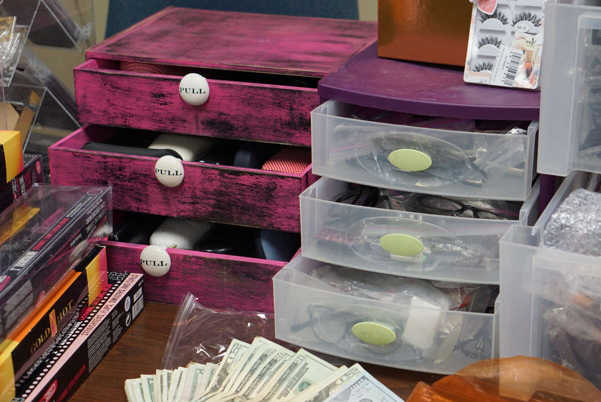 Police say they uncovered a fencing operation and found more than $30,000 in stolen and counterfeit property and $6,500 in cash on Wednesday June 22, 2016.