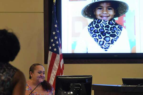 Patty Ojeda, maternal grandmother of Josiah Williams, a 5-year-old who died after being allegedly abused, looks fondly at a picture of the child as state's attorney Stephanie Boyd stands by in Judge Ron Rangel's 379th District Court on Wednesday, June 22, 2016.