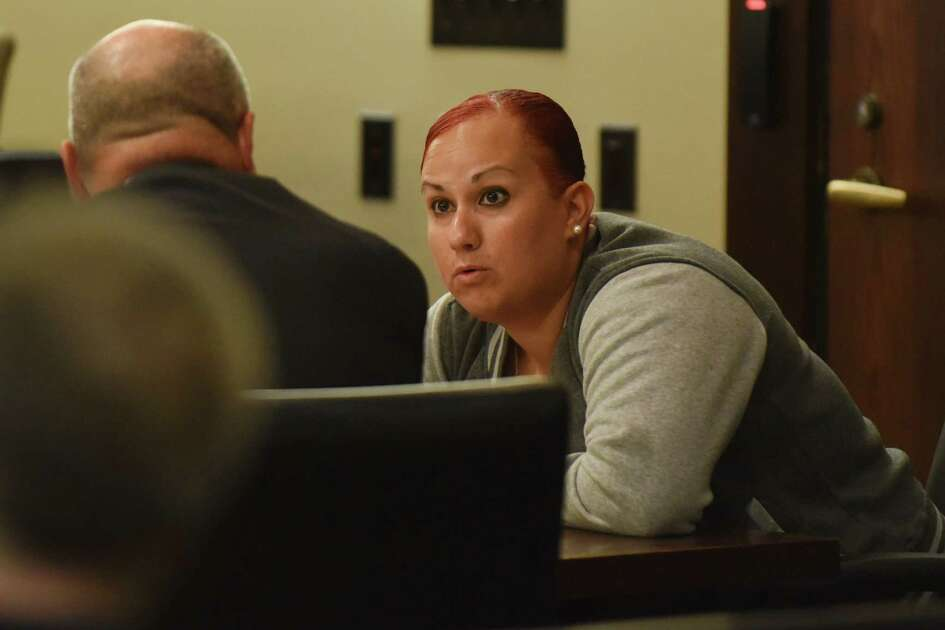 Crystal Williams, who is facing a felony charge of injury of a child related to the death of 5-year-old Josiah Williams, speaks with attorney Ray Martinez in Judge Ron Rangel's 379th District Court on Wednesday, June 22, 2016.