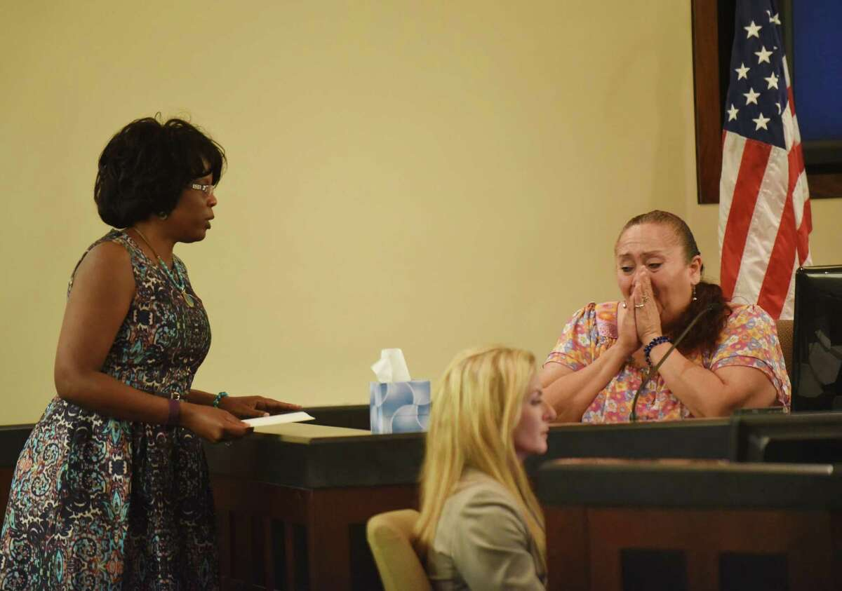 Patty Ojeda, maternal grandmother of Josiah Williams, a 5-year-old who died after being allegedly abused, weeps after being shown a picture of the child as state's attorney Stephanie Boyd stands by in Judge Ron Rangel's 379th District Court on Wednesday, June 22, 2016.