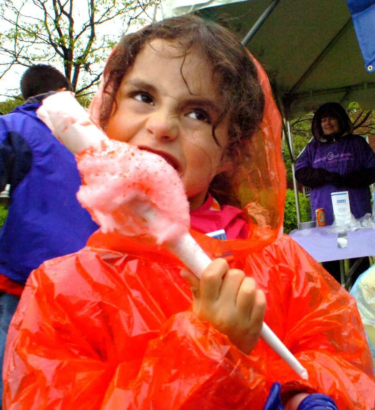 Eliza Roth, 6, of Newtown, digs into her cotton candy during the March of Dimes annual March for Babies at the City Center Green in Danbury on Sunday, April 25, 2010.