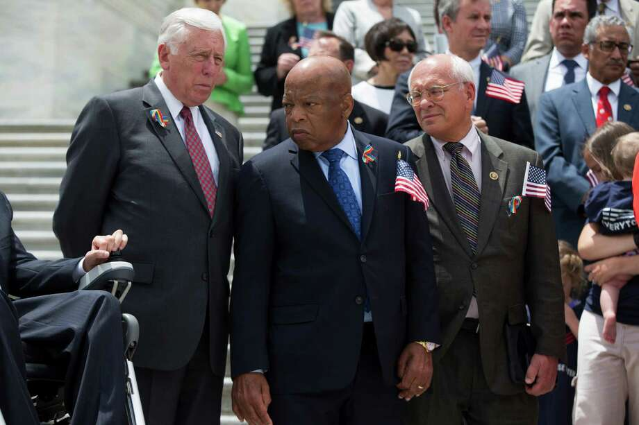 Rep. John Lewis, D-Ga., , flanked by House Minority Whip Steny Hoyer of Md., left, and Rep. Paul Tonko, D-N.Y., participate in a news conference on gun legislation, Wednesday, June 22, 2016, on Capitol Hill in Washington. (AP Photo/Evan Vucci) ORG XMIT: DCEV122 Photo: Evan Vucci / Copyright 2016 The Associated Press. All rights reserved. This m