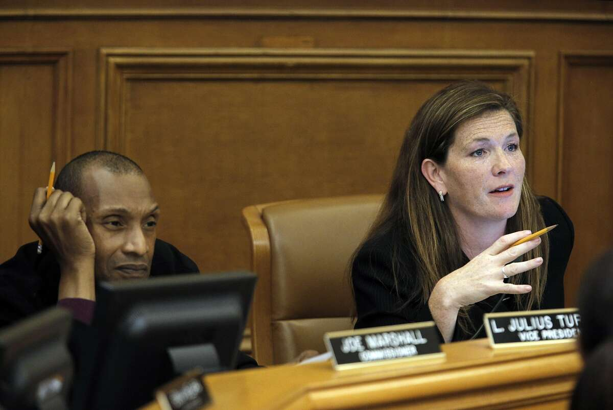 Commission President Suzy Loftus, right, talks to a speaker as the San Francisco Police Commission discussed a new use of force policy at City Hall in San Francisco, Calif., on Wednesday, June 22, 2016.
