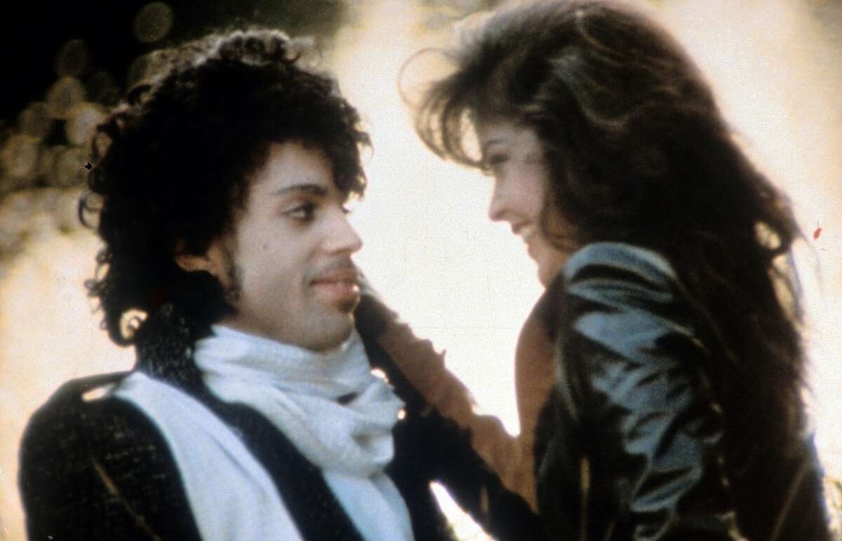 Prince embraces Apollonia Kotero in a scene from the 1984 film 'Purple Rain.'
