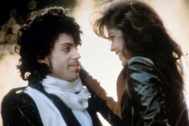 Prince embraces Apollonia Kotero in a scene from the 1984 film 'Purple Rain.'