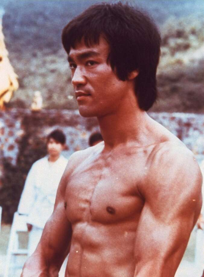 """**FILE**  Bruce Lee is shown in a scene from the 1973 film, """"Enter the Dragon,""""  completed shortly before the martial arts stars' death of brain edema in 1973. China has honored movie stars Bruce Lee, Jackie Chan and Chow Yun-Fat in a commemorative stamp collection marking 100 years of Chinese cinema.   (AP Photo/HO, FILE) Photo: AP"""