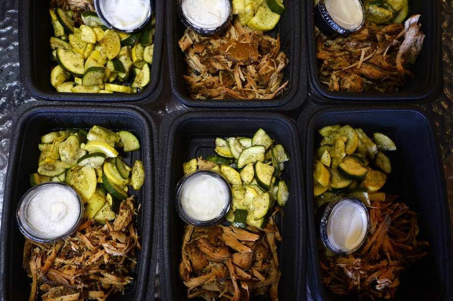 Prepared meals of pork tenderloin and grilled squash and zucchini at For the Love of Foods in Nederland. The company changes their menu of boxed meals twice a week. Photo taken Friday 6/17/16 Ryan Pelham/The Enterprise Photo: Ryan Pelham/The Enterprise