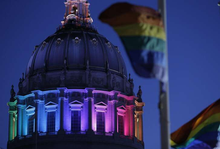 The dome of the Rotunda at City Hall was awash in the colors of the Rainbow Flag for Pride Week in San Francisco, Calif., on Wednesday, June 22, 2016.