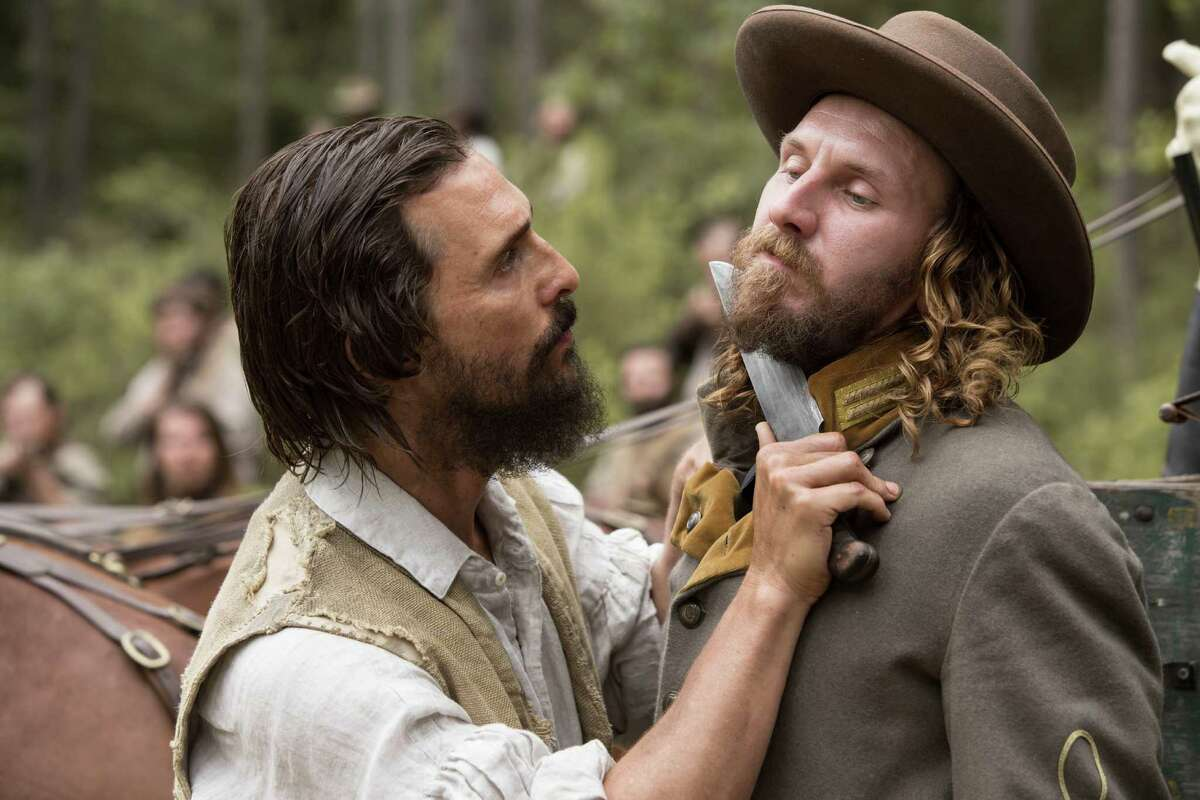 "Matthew McConaughey (left) and Bill Tangradi in ""The Free State of Jones."""