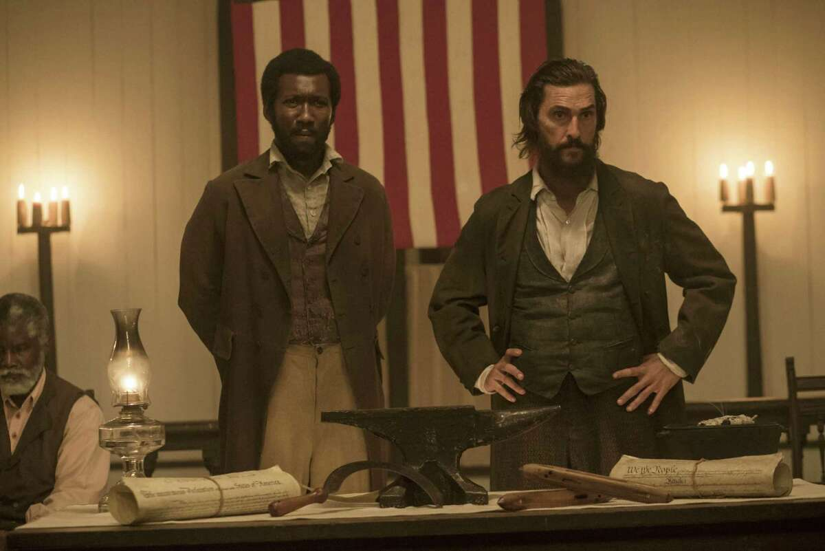 """This image released by STX Productions shows Mahershala Ali, left, and Matthew McConaughey in a scene from """"The Free State of Jones."""" (Murray Close/STX Productions via AP)"""