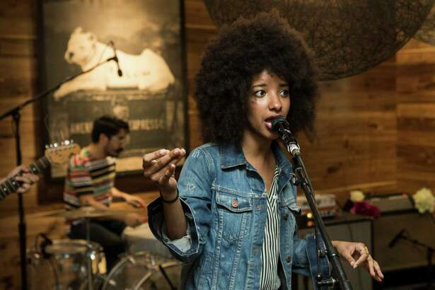 The Tontons lead singer Asli Omar perfors during the preview party for the American Express Centurion Lounge opening at George Bush Intercontinental Airport on Wednesday, June 22, 2016, in Houston.