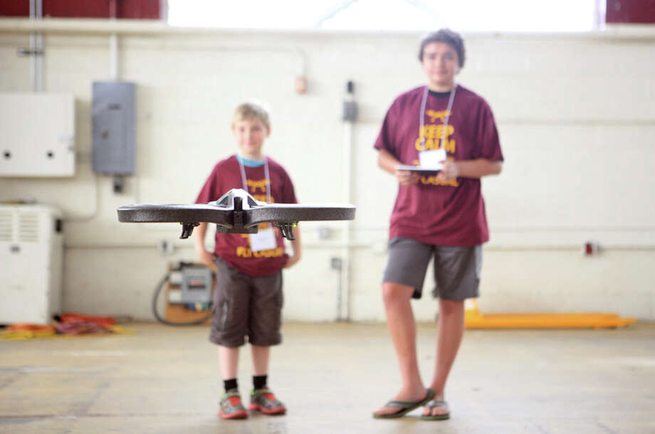 Photo provided Drone camp kicks off with teaching the middle school students basic functions when controlling a drone. The camp took place in Finch Fieldhouse on the campus of Central Michigan University. / Brianna Hughes