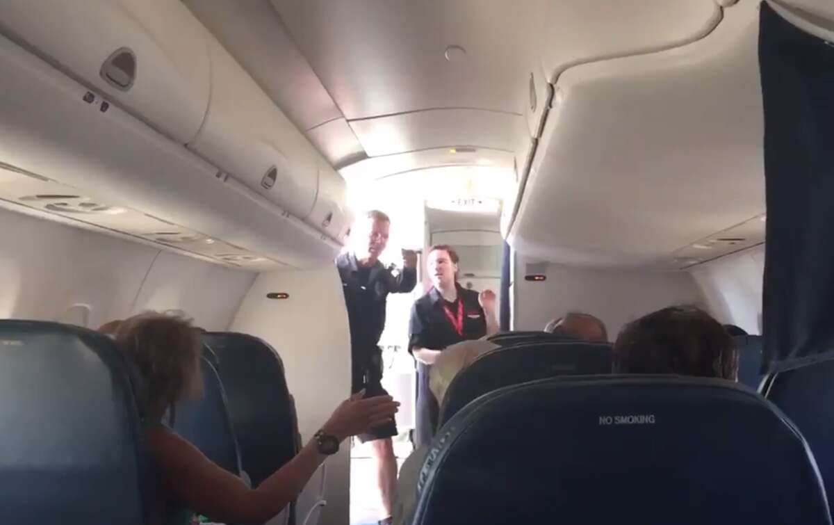 @RyanHealy captured video of authorities removing the passenger who allegedly created the in flight disturbance on June 22, 2016.