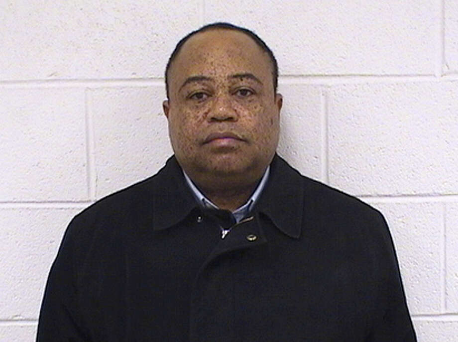 Rev. Honore Kombo, a Roman Catholic Priest was arrested by Seymour Police Detectives Feb. 29, 2016 for embezzling money from St. Augustine Church in Seymour. Photo: Contributed Photo / Contributed Photo / Connecticut Post Contributed