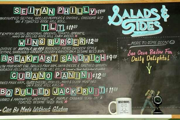 One half of the menu board at Berben & Wolff's Vegan Delicatessen on Lark Street in Albany. (Lori Van Buren / Times Union)