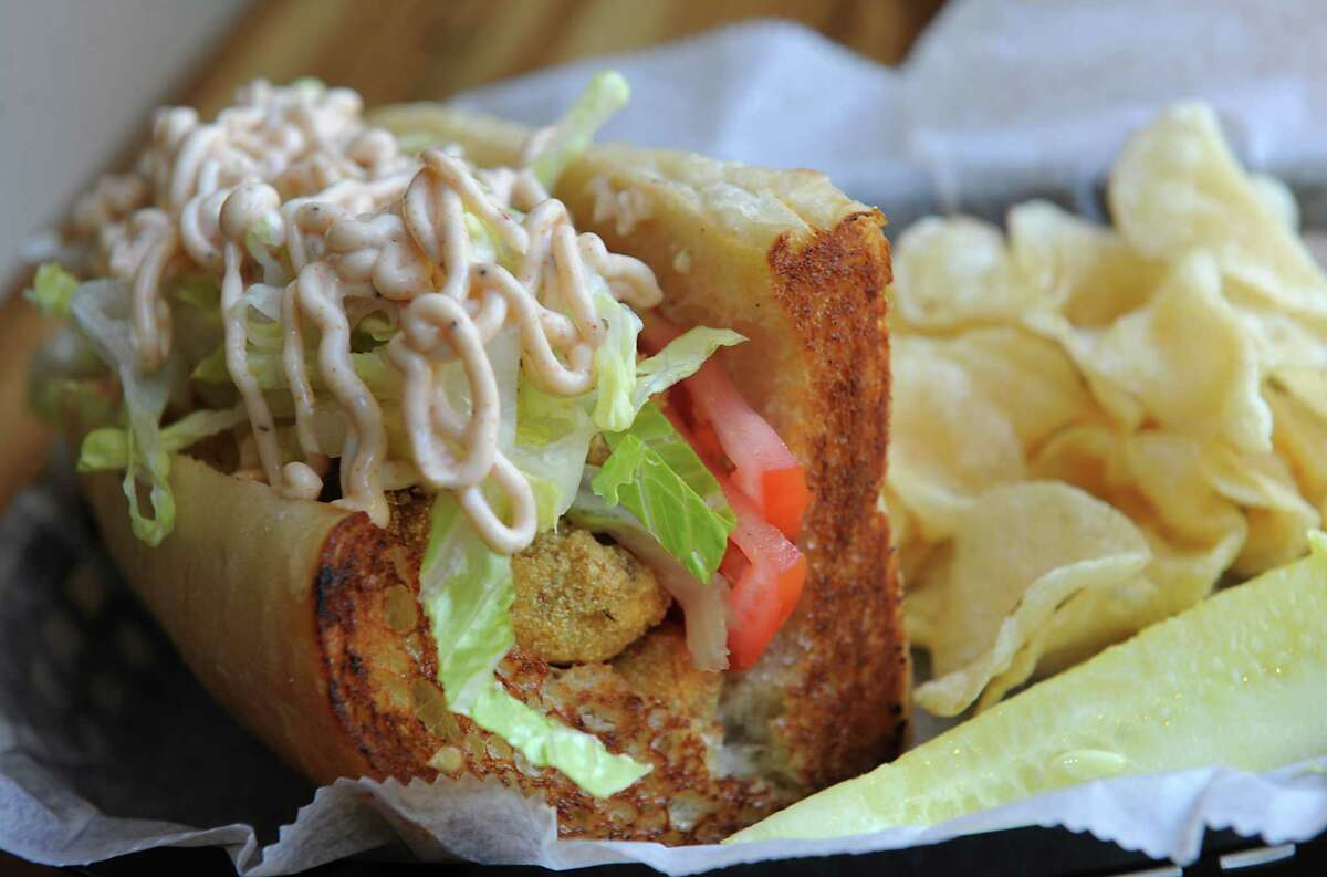 Popcorn mushroom po' boy sandwich at Berben & Wolff's Vegan Delicatessen on Lark Street in Albany, N.Y. The sandwich includes cornmeal encrusted seasonal mushrooms, lettuce and tomato with Old Bay remolaude on a toasted Rock Hill Bakery sub roll. (Lori Van Buren / Times Union)
