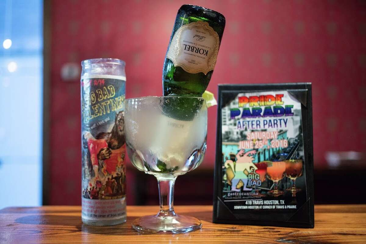 """El Big Bad gastrocantina in downtown Houston celebrates Pride Houston with Pride Margaritas include """"The Unicorn"""" Margarita with an upside down mini champagne bottle."""