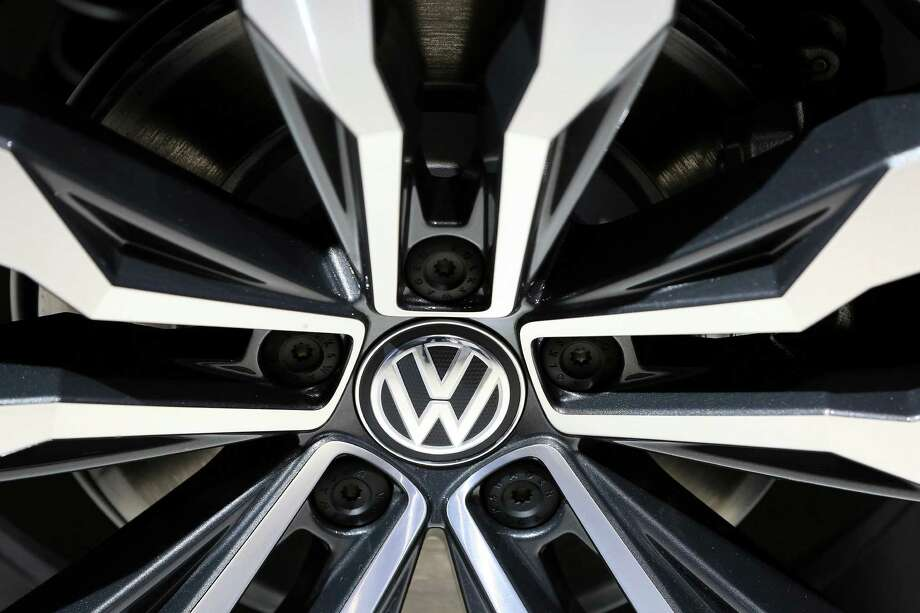 VW will provide cash payments worth between $1,000 and $7,000, depending on the vehicle's age and other factors, to compensate consumers, people familiar with the talks said. Photo: Krisztian Bocsi /Bloomberg News / © 2016 Bloomberg Finance LP
