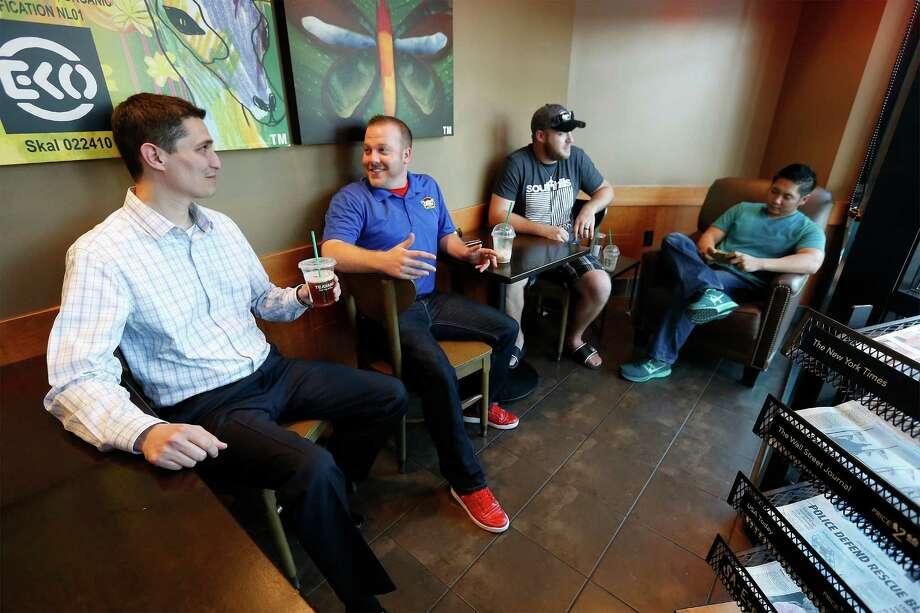 "Charles ""Chuck"" Puente (from left), Jerome Bartlett, TJ Bartlett and Darren Crisotomo of Higher Impact Entertain- ment. Photo: Kin Man Hui /San Antonio Express-News / ©2016 San Antonio Express-News"
