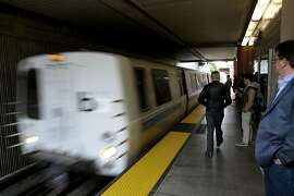 A BART train pulls into the Millbrae station along the BART system in San Francisco, California, on Thurs. June 23, 2016. BART is unveiling its system for fining passengers who take up more than a single seat on a train.