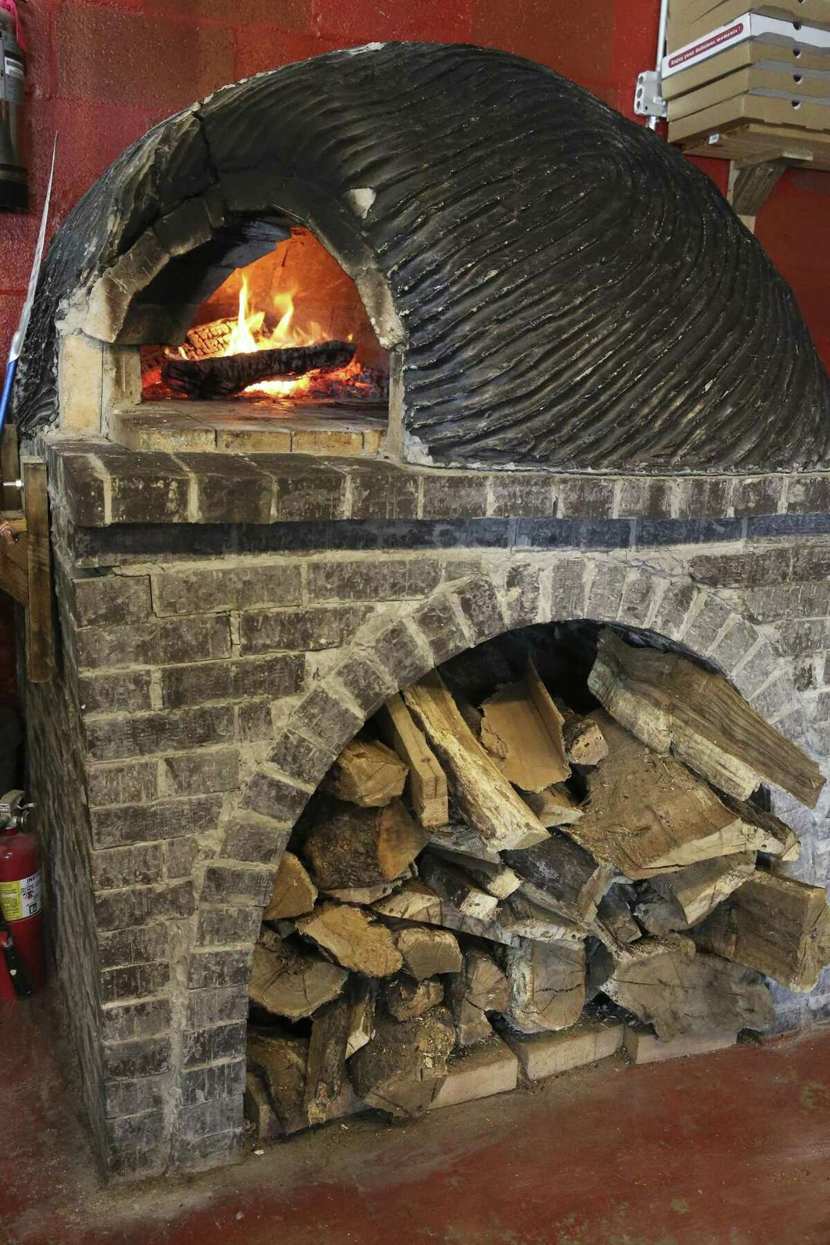 The brick oven built by chef/owner Michael Sohocki stands as the focal point of Il Forno.