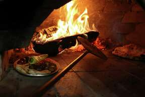 """Chef/owner Michael Sohocki built by hand the wood-burning oven that serves as the heart of the restaurant. Il Forno means """"the oven"""" in Italian."""