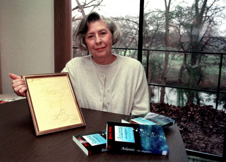"Author, Joyce Steel, holds the piece of tablet paper which was the first inspired writing from ""Harry"" , the force which communicated ideas to her."