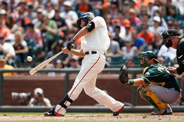 SAN FRANCISCO, CA - JULY 25: Madison Bumgarner #40 of the San Francisco Giants hits a solo home run in the third inning against the Oakland Athletics at AT&T Park on July 25, 2015 in San Francisco, California.  (Photo by Lachlan Cunningham/Getty Images)