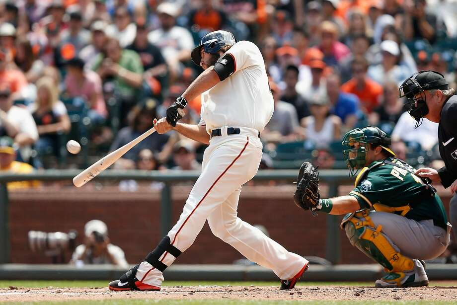 Madison Bumgarner, homering last season against the A's, has expressed interest in participating in the Home Run Derby. Photo: Lachlan Cunningham, Getty Images