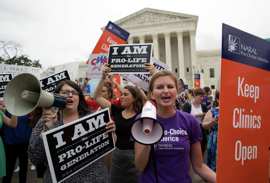 Pro-abortion rights and anti-abortion protesters rally in front of the U.S. Supreme Court in Washington, June 23, 2016. The protesters were hoping for a decision by the court in a major abortion case, Whole Woman's Health v. Hellerstedt. (Stephen Crowley/The New York Times) Photo: STEPHEN CROWLEY, NYT / NYTNS