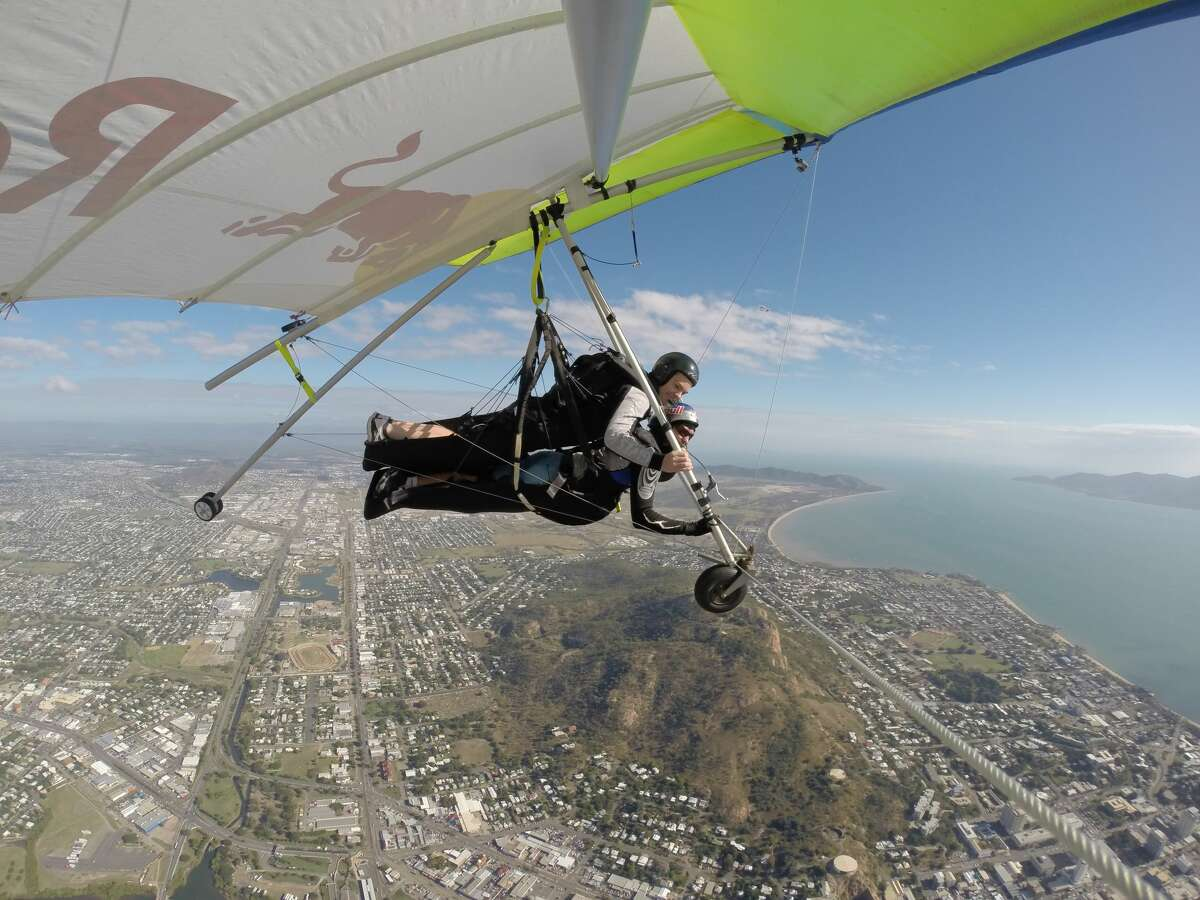 Red Bull Racing Australia driver, Craig Lowndes, and world-record holding hang-glider Jonny Durand took to the skies ahead of the Townsville 500 in Townsville, Australia on July 3, 2014.
