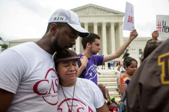 WASHINGTON, DC - JUNE 23: Rosario Reyes, an undocumented mother from El Salvador, reacts to news on a Supreme Court decision blocking Obama's immigration plan, which would have protected millions of immigrants from deportation, in front of the U.S. Supreme Court, on June 23, 2016 in Washington, DC.  The court was divided 4-4, leaving in place an appeals court ruling blocking the plan.
