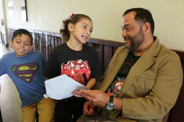 Homero Garza, 42, entertains his children, Yvanna, 7, and Abraham, 11, after a Father's Day service at Abundant Life Church of God north side campus recently. Garza and his wife, Myrna, 42, are undocumented immigrants from Nuevo Rosita, Mexico but their two children are U.S. citizens. They would have been protected from deportation by an executive order signed by President Barak Obama creating the Deferred Action for Parents of Americans and Lawful Permanent Residents, (DAPA) in November 2014. A Supreme Court deadlock Thursday leaves an injunction on the program intact.