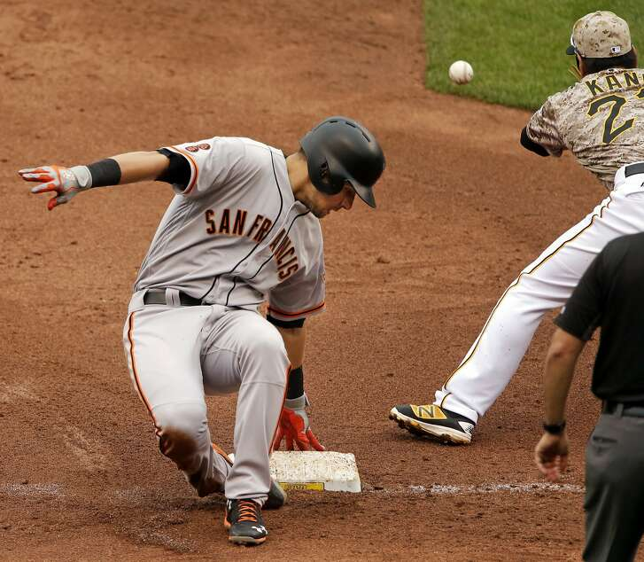 San Francisco Giants' Joe Panik, left, slides safely into third with a bases loaded triple as Pittsburgh Pirates third baseman Jung Ho Kang fields the late relay throw during the third inning of a baseball game in Pittsburgh, Thursday, June 23, 2016. (AP Photo/Gene J. Puskar)
