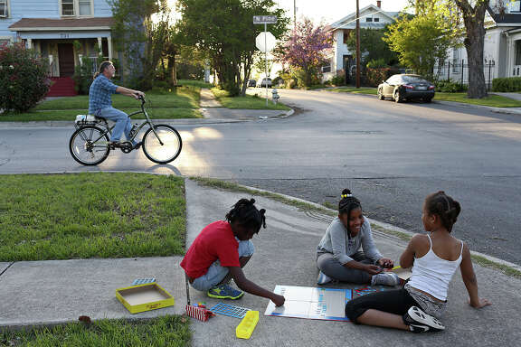 Kelli Hawkins, 8, Alayla Brown, 9, and Alorah Kindred, 10, play outside their homes on a Friday afternoon in Dignowity Hill on March 25, 2016.