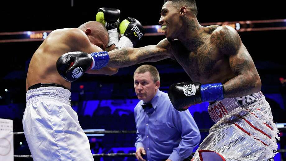 Justin DeLoach (right) punches Santos Benavides during their Dec. 12, 2015, bout in San Antonio Photo: Suzanne Teresa /Premier Boxing Champions / photo suzanneteresa.com