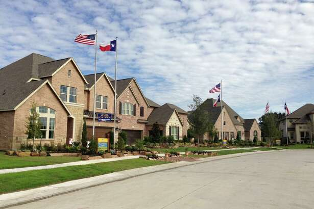 Homes in the Houston area had a median listing time of 55 days, and a median list price of $333,200 in June, according to realtor.com. Model homes show options in Pomona in Manvel. (Katherine Feser  /  Houston Chronicle)