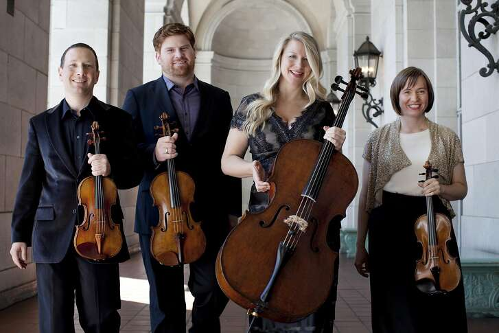 From left, violinist Tom Stone, violist Ethan Filner, cellist Jennifer Kloetzel and violinist Cecily Ward make up the Cypress String Quartet, which will be playing in Stamford, Conn., on March 23, 2014.